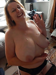 Elegant-looking aged mom is giving blowjob