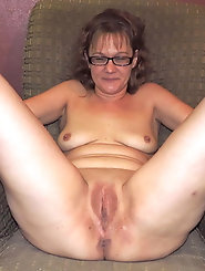Mature mistress is spreading hips