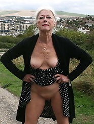 Older MILF is showing off her breasts
