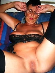 Sexy tanned dark haired granny with killer body