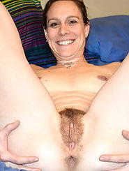 Filthy grandmom is fingering her holes