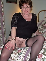 Sensational older woman is spreading her pussy on picture